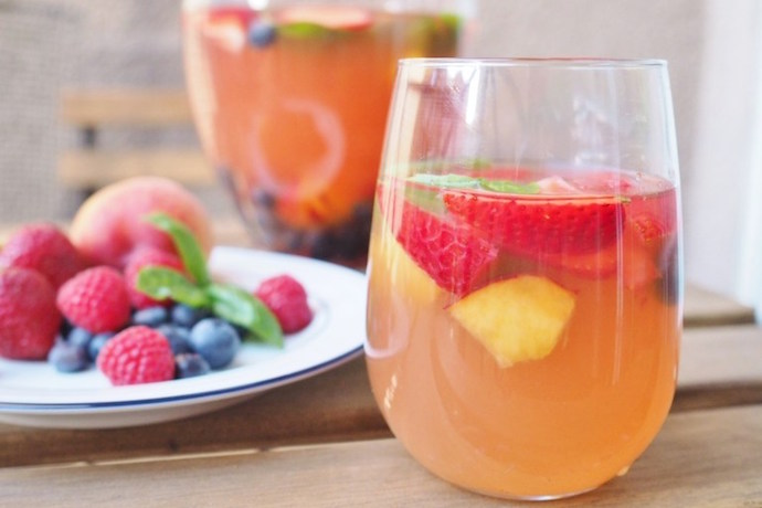 8 tasty twists on the traditional summer sangria recipe. Yum!