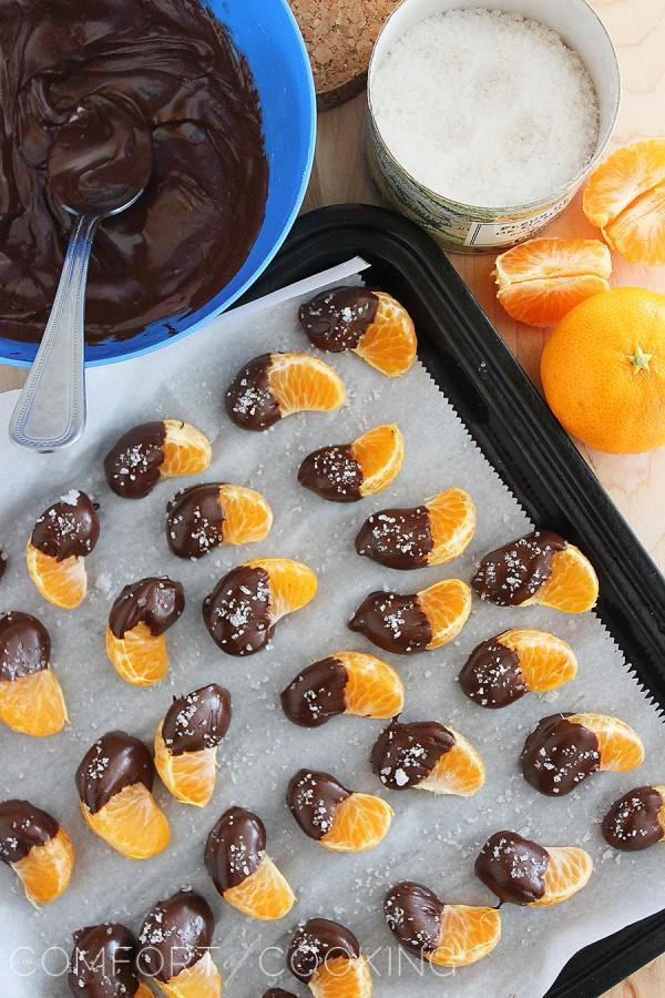 Sweet treats that are lower in sugar to give your kids the healthy after school boost they need: Chocolate Dipped Clementines with Sea Salt at Comfort of Cooking