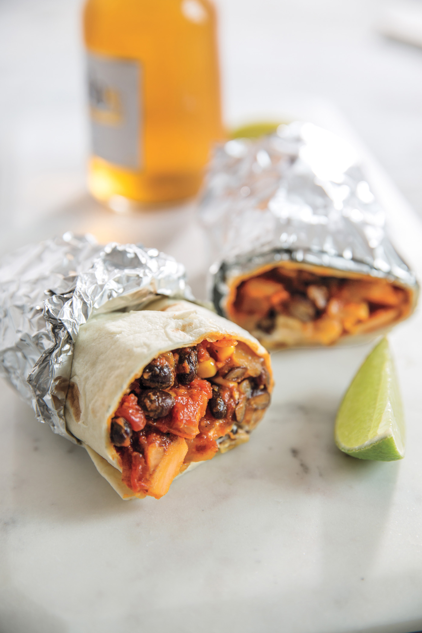 Kitchen Sink Burritos from The Dinner Plan cookbook by Kathy Brennan and Caroline Campion: Not just an easy meal, but one that can be staggered for when everyone's coming home at a different time. A smart family dinner lifesaver! | Cool Mom Eats