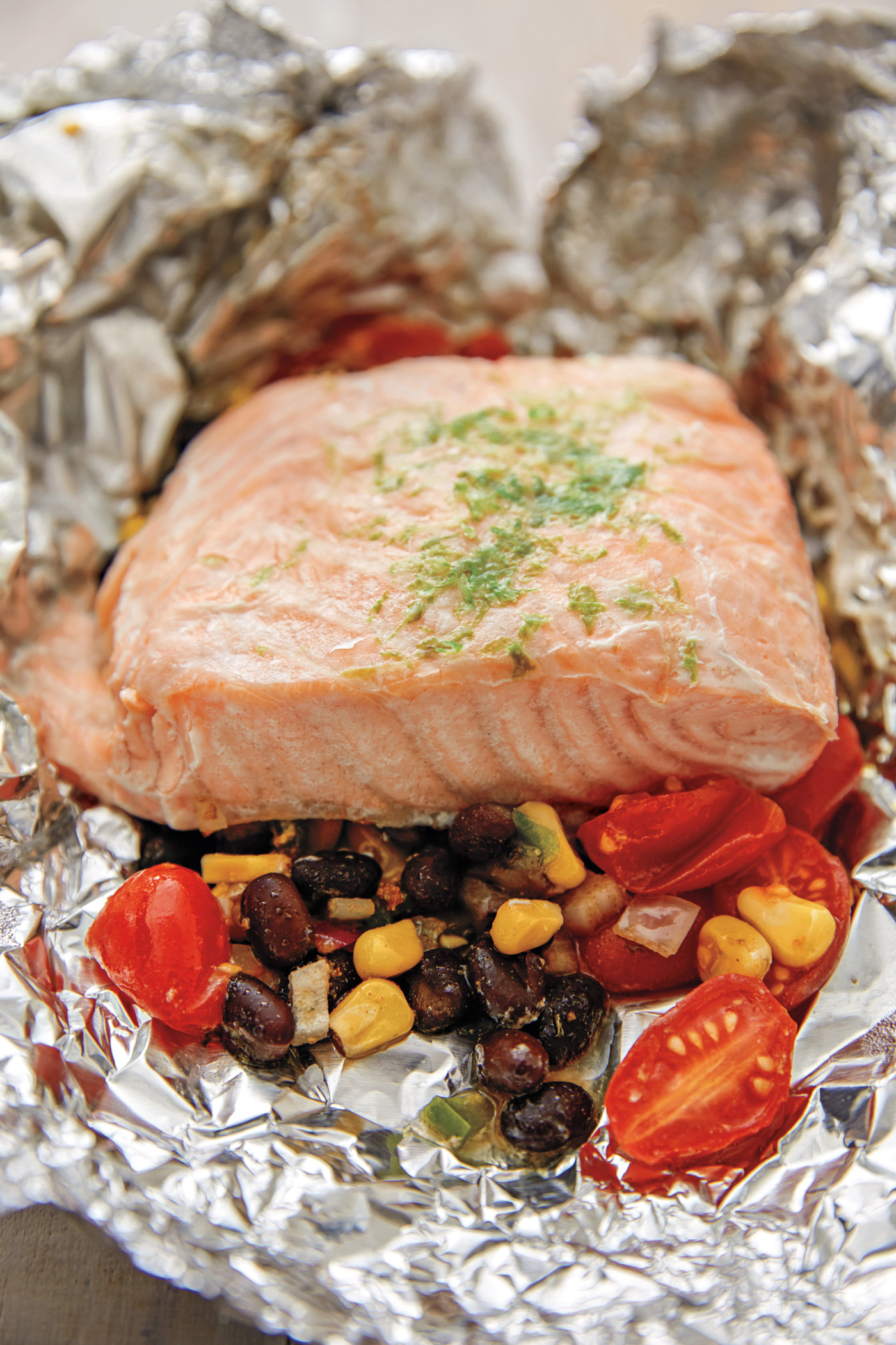 Tex-Mex Salmon in Foil, plus tips on how to cook en papillote (or how to cook in parchment) from The Dinner Plan Cookbook by Kathy Brennan and Caroline Campion | Cool Mom Eats (Photo by Maura McEvoy)