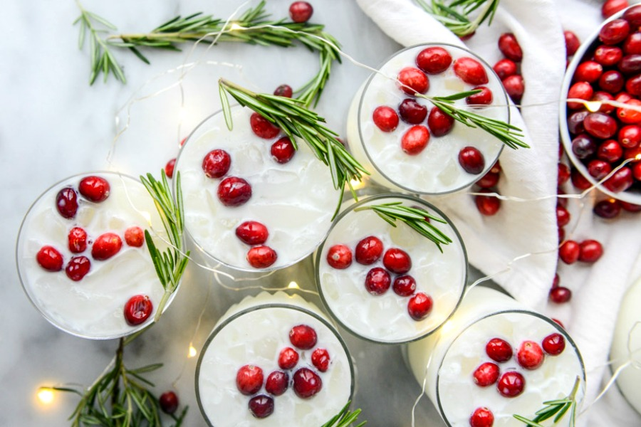 Fabulous make ahead holiday cocktail recipes you can prep ahead so that you can be merry with your guests, including this White Christmas Margarita Punch at How Sweet Eats