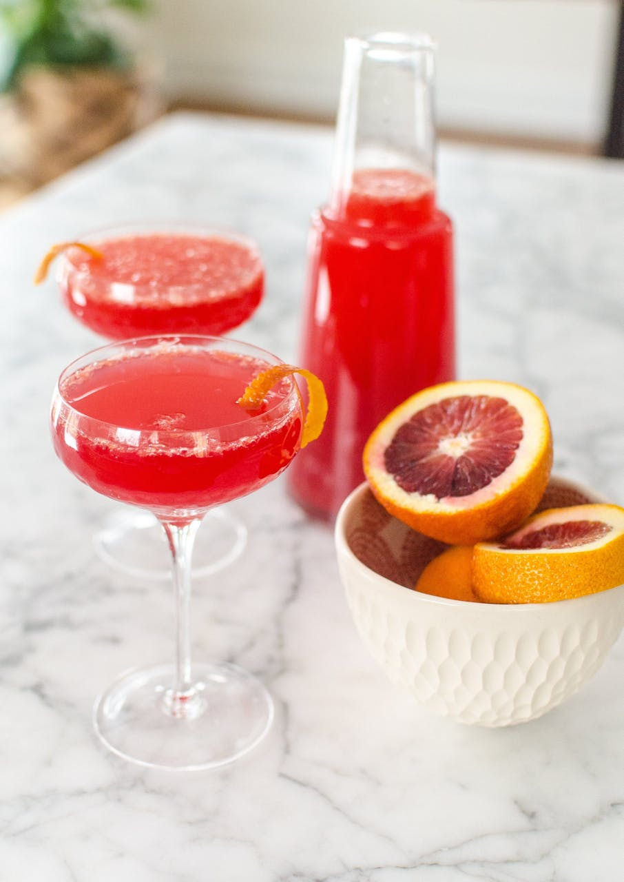 Make ahead holiday cocktail recipes | blood orange mimosa pitcher cocktail at The Kitchn.