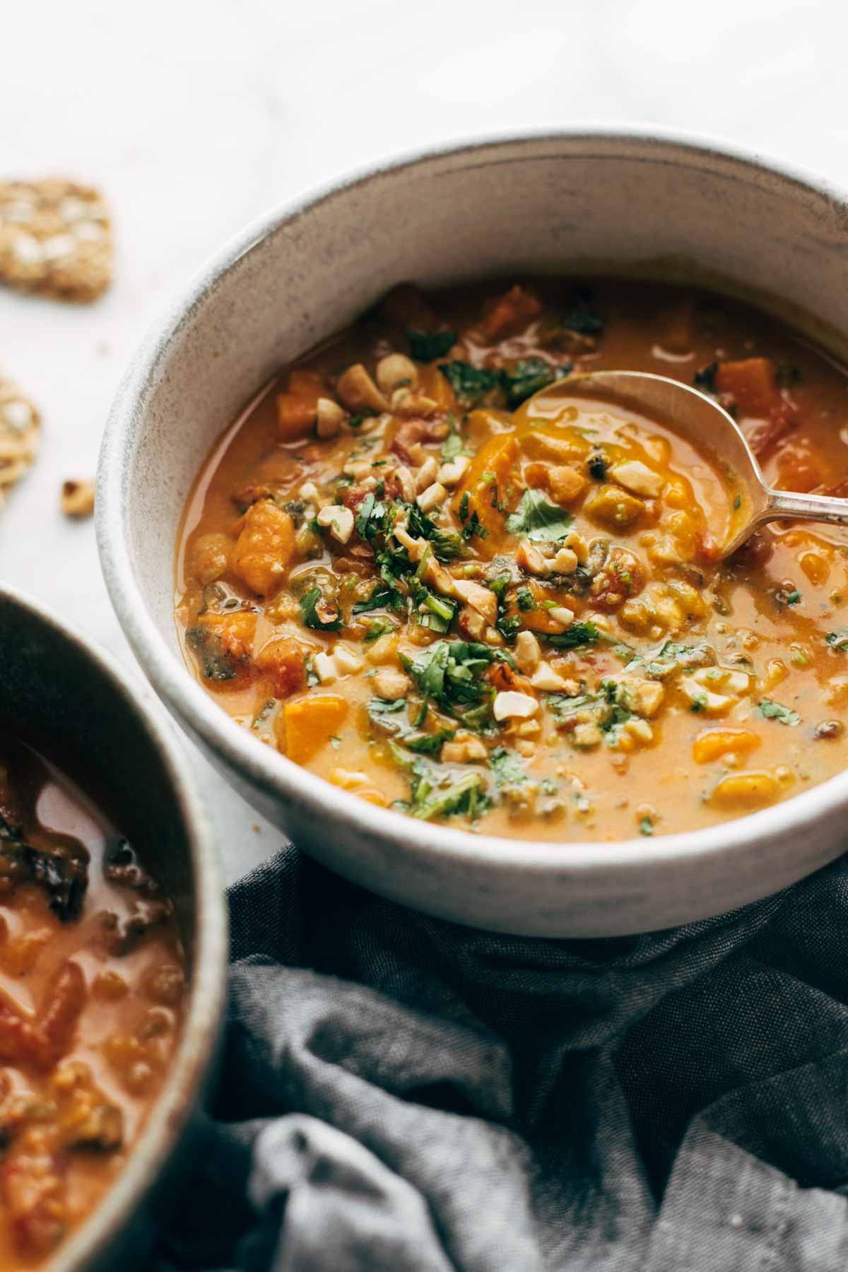 Skinny Instant Pot recipes: Spicy Peanut Soup with Sweet Potatoes and Kale | Pinch of Yum