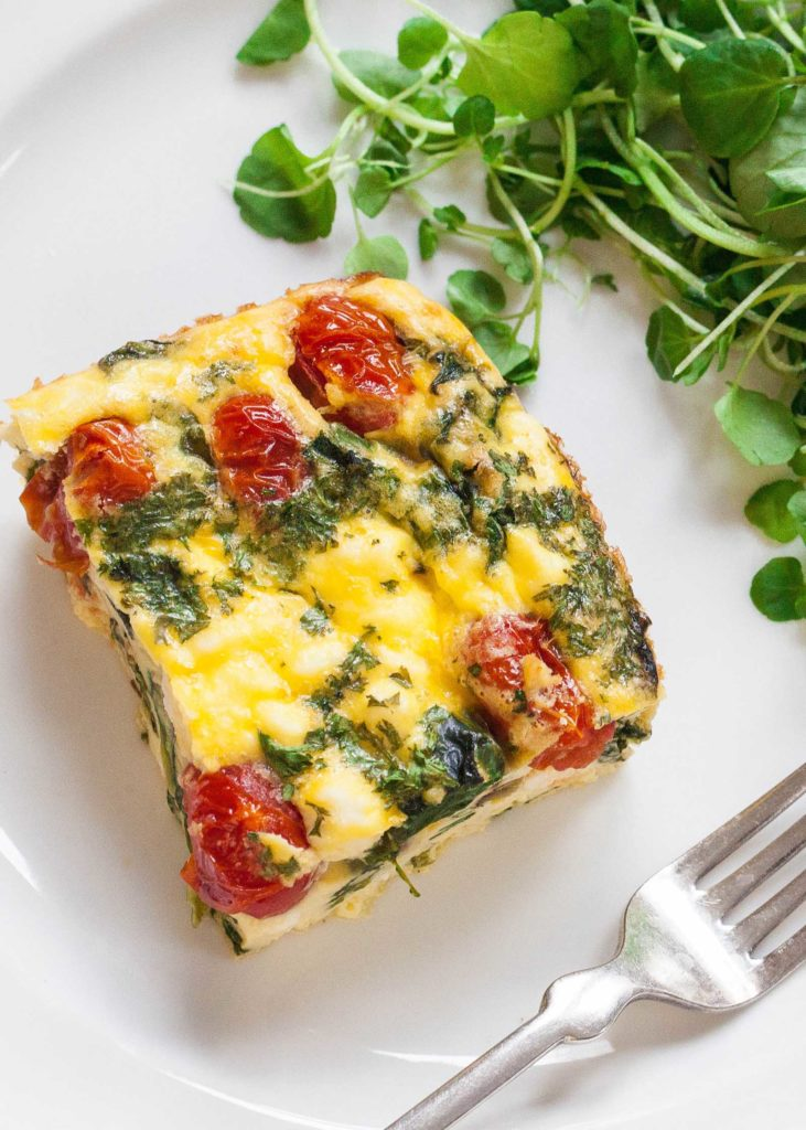 Make-ahead easter brunch ideas: Make-Ahead Egg Bake (or Fritatta) with Spinach, Tomato, and Feta from Sally Vargas for Simply Recipes