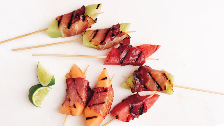 10 outdoor cookout hacks and recipes to try: Prosciutto wrapped melon on sticks from Martha Stewart. Grilled!