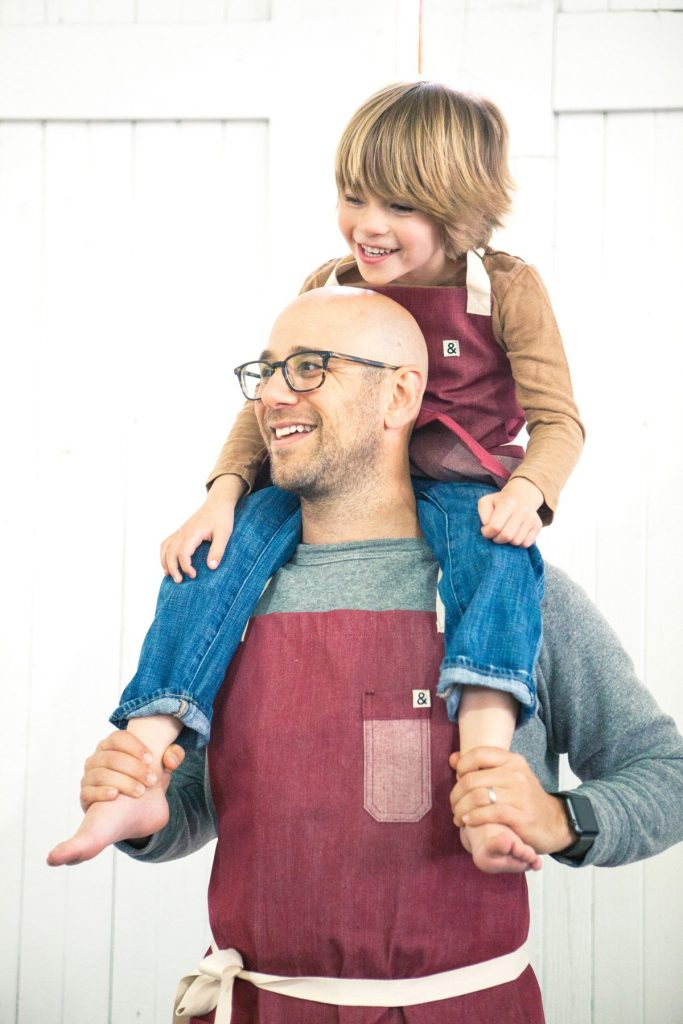 Gifts for dads who cook: A Daddy & Me apron set from Hedley & Bennet supporting PROJECT (RED