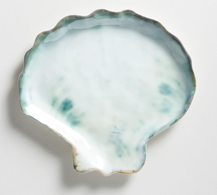 Must-have melamine dishes for outdoor entertaining: Shell-shaped melamine plates at Pottery Barn