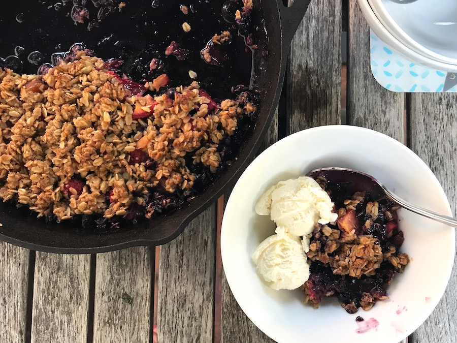 The perfect summer dessert on the grill: A fresh berry crisp with vanilla ice cream | Recipe © Jane Sweeney for Cool Mom Eats