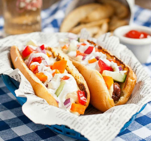 Creative hot dog toppings: Greek style dogs with hummus, veggies and tzatziki from Neighborhood Food Blog