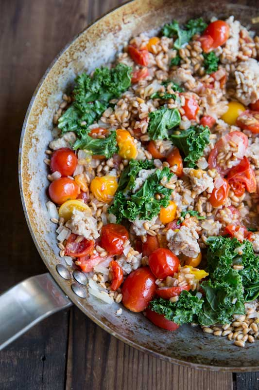 Simple ways to use farro: One-Pan Farro with Tomatoes, Sausage and Kale | The Vintage Mixer