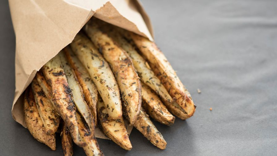 Mashed potato alternatives for the holidays: Little Piece of Healthy Heaven Baked French Fry recipe from Genius Kitchen is dusted with herbs and parmesan