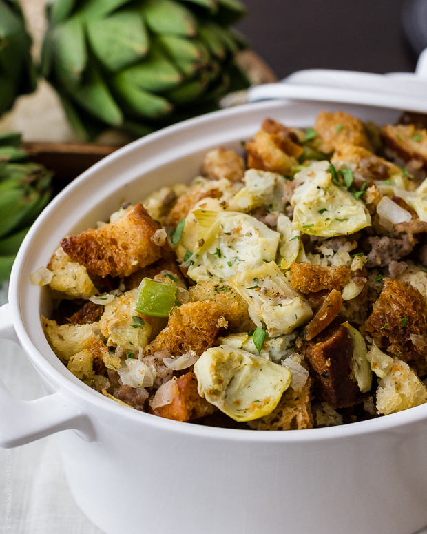 Best Thanksgiving stuffing recipes: Artichoke Sourdough Stuffing with Sausage at Kitchen Confidante