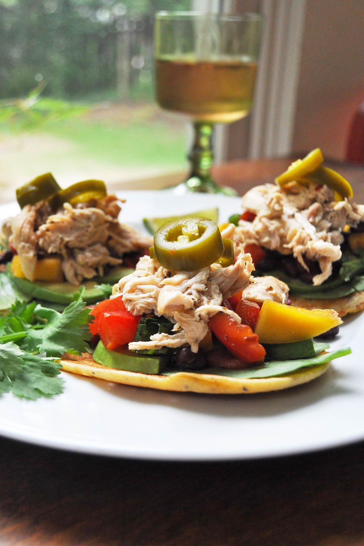 Easy slow cooker pulled chicken recipe: Served  in socca wrap tacos   Anne Wolfe Postic for Cool Mom Eats