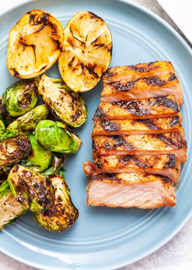 Spring meal ideas to lighten up family dinnertime: Citrus brined grilled pork chops via Simply Recipes
