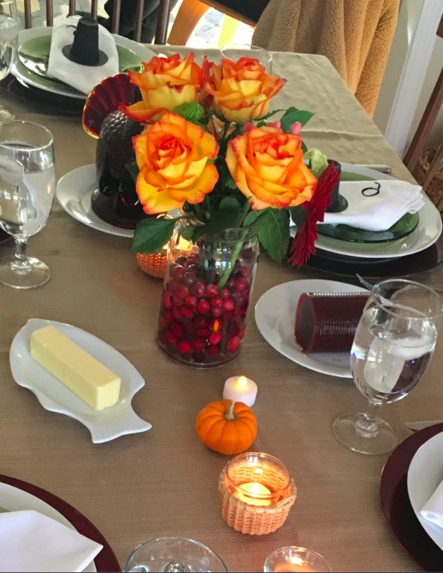 Eco-friendly table settings for Thanksgiving with cranberries and flowers