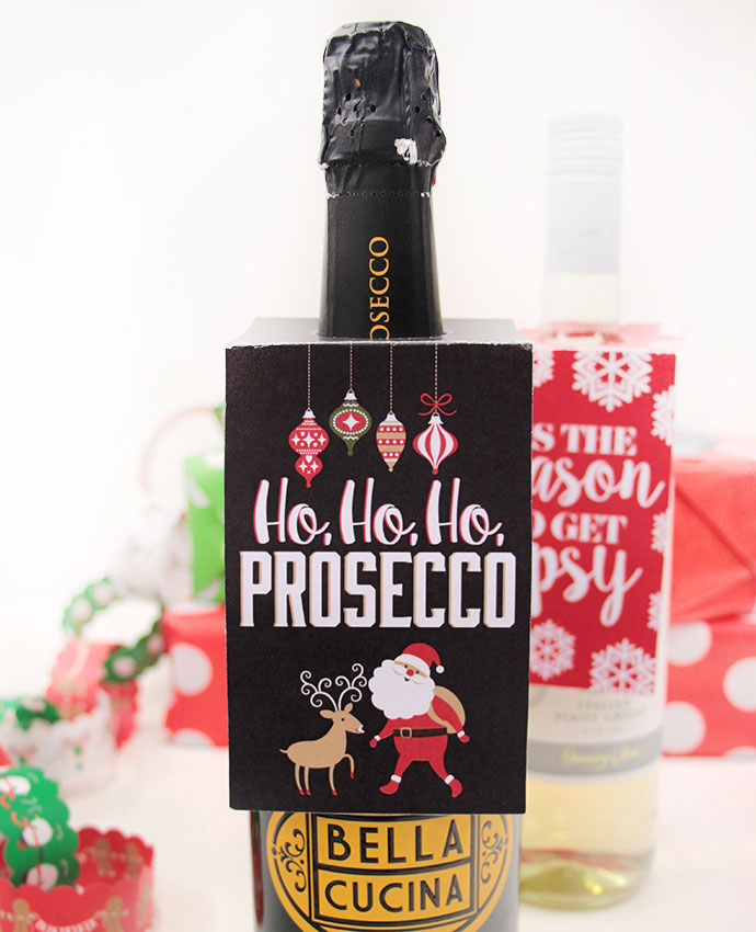 8 creative ways to gift wrap a bottle of wine: Try with free, printable gift tags like these from Party Delights