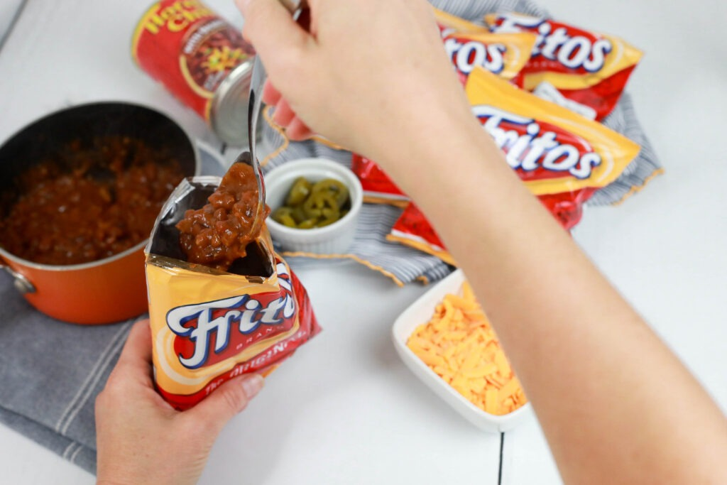 6 easy hot lunches your kids can make themselves: These Walking Frito pies from 5 dinners 1 hour are such a classic.