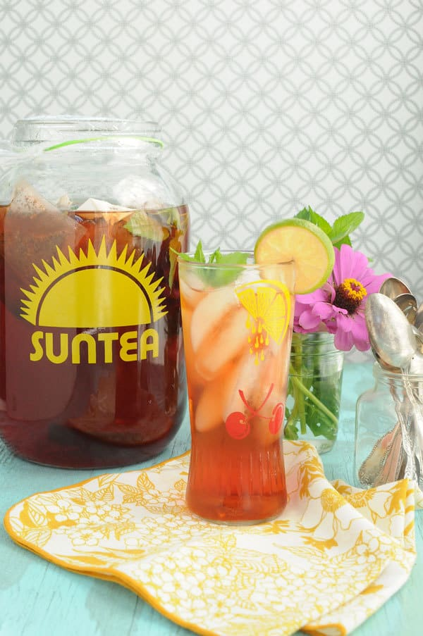 Add fresh fruit to your sun tea | Raspberry Lime sun tea at Two Lucky Spoons