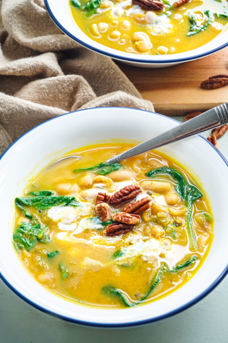 Creative pumpkin recipes for fall: Pumpkin soup with spinach and beans at Posh Plate