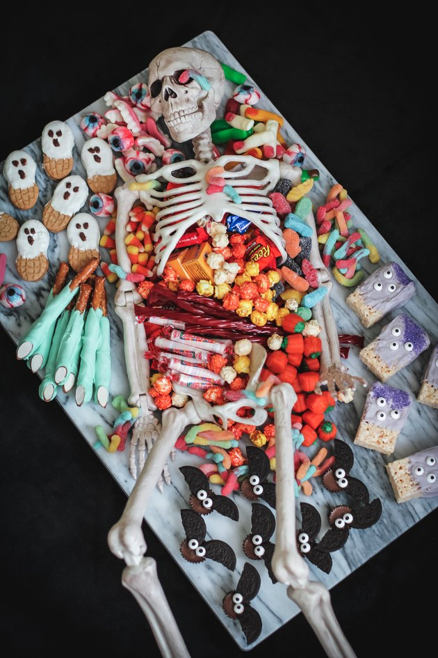 Amazingly creative Halloween snack tray by E How featuring a big plastic skeleton