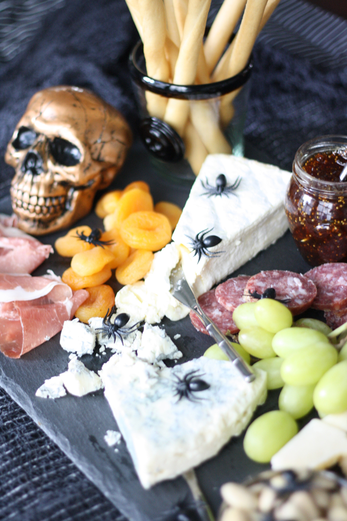 Halloween snack tray upgrades a traditional charcuterie board with plastic spiders and bugs by Annette Joseph Style