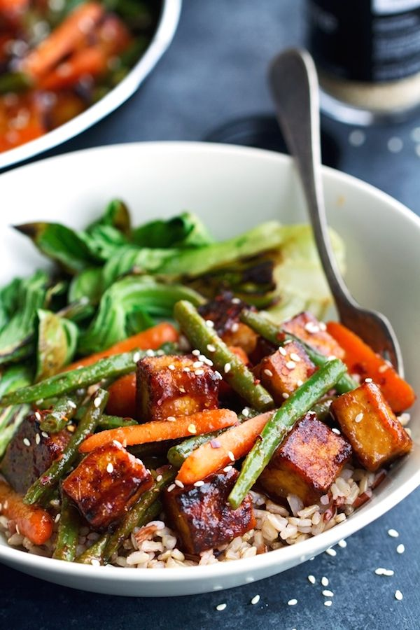 Eat more vegetarian meals to save money on groceries like this veggie stir fry from Little Spice Jar