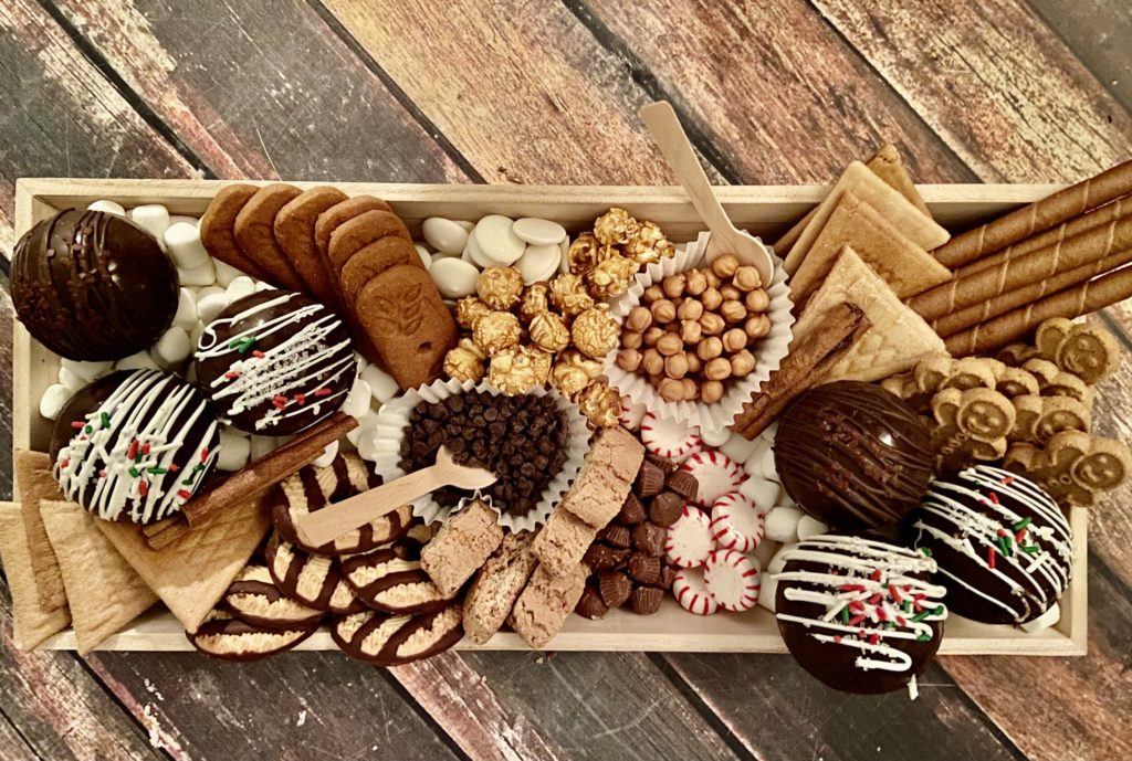 Order your own Christmas hot cocoa bomb charcuterie board from Buttercream and Sprinkles