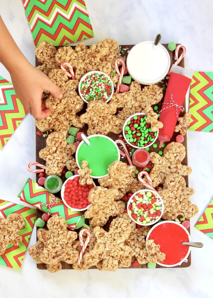 Have a no-bake gingerbread men decorating party with this snack tray idea from The Baker Mama