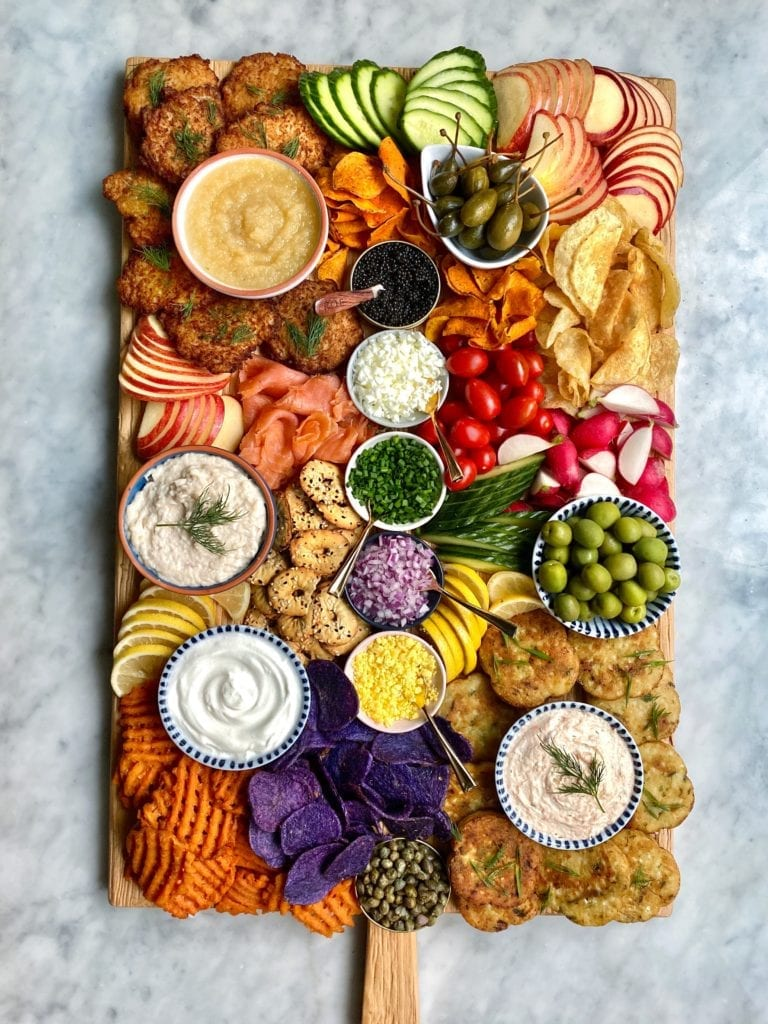 Create a latke charcuterie board, like this one from Ain't Too Proud to Meg, to help celebrate Hanukkah