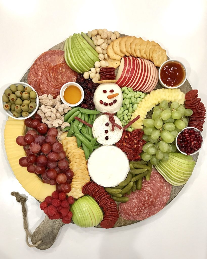 Surprise the kids with this Snowman Charcuterie snack board from The Baker Mama