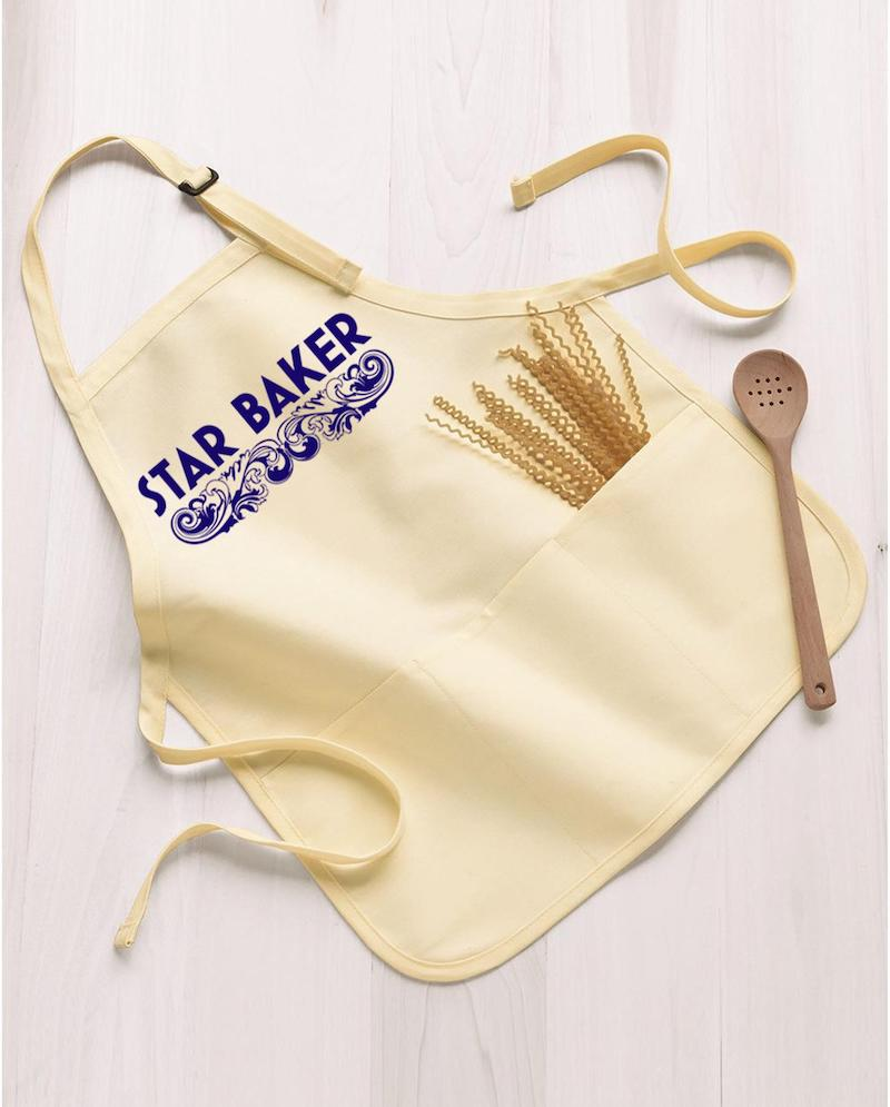 Gifts for Great British Baking Show fans: A star baker apron for the best baker you know.