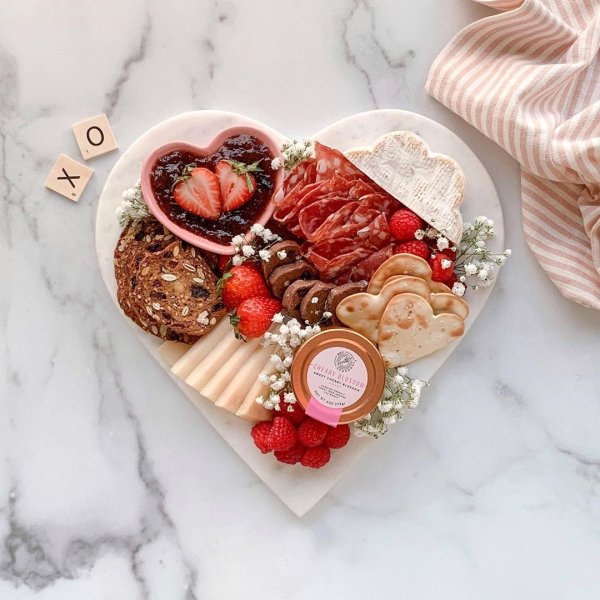 Our favorite boards for charcuterie boards: This marble heart board at Williams Sonoma isn't just for Valentine's Day! Here are some ideas for using it.