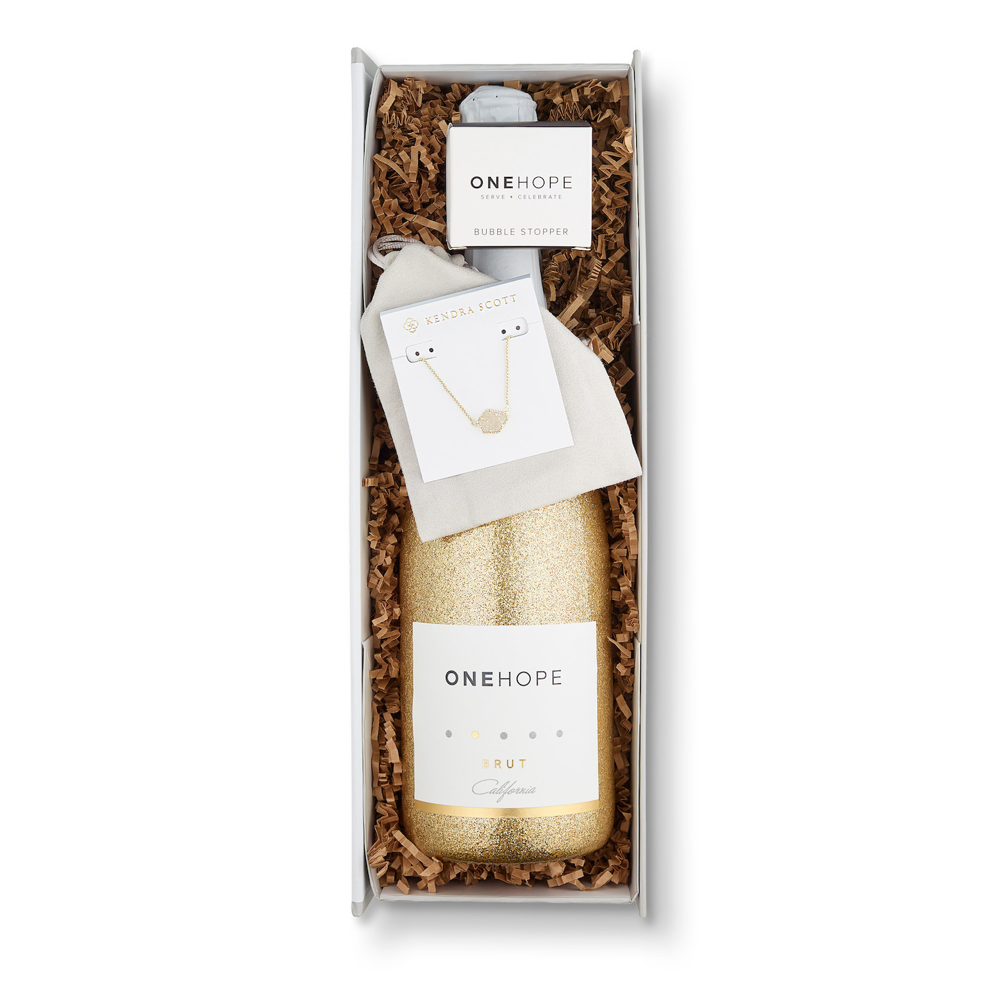 Romantic Valentine's Food gifts: Kendra Scott gift box of Champagne from One Hope gives you a bauble with those bubbles!