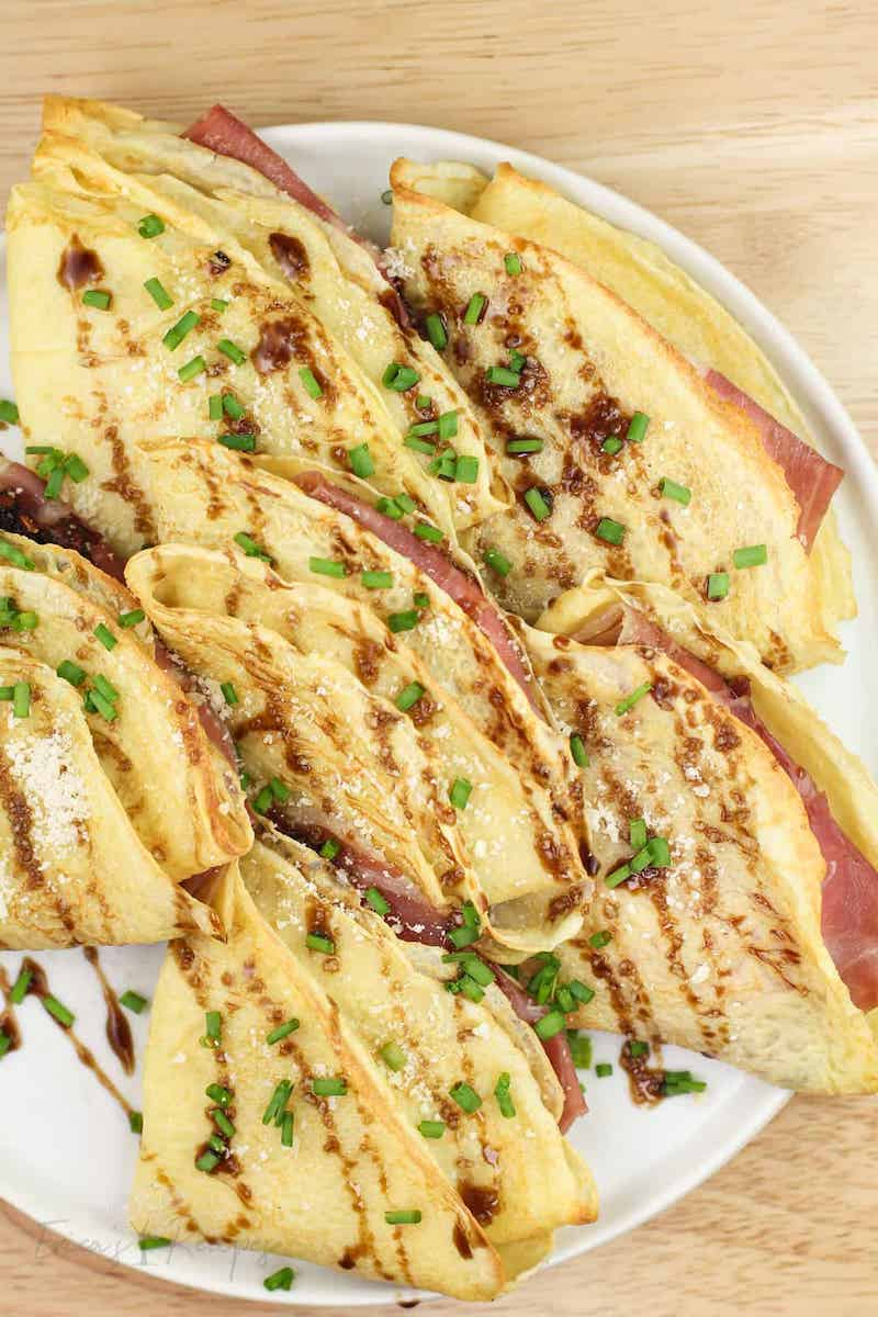 Easy spring appetizers for dinner at home: Crepes with prosciutto and cheese at Erica's Recipes are like fancy finger sandwiches but so easy to make
