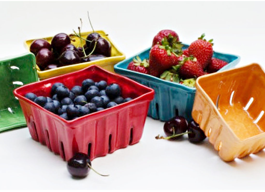 Handmade ceramic berry bowls that look like farmer's market baskets