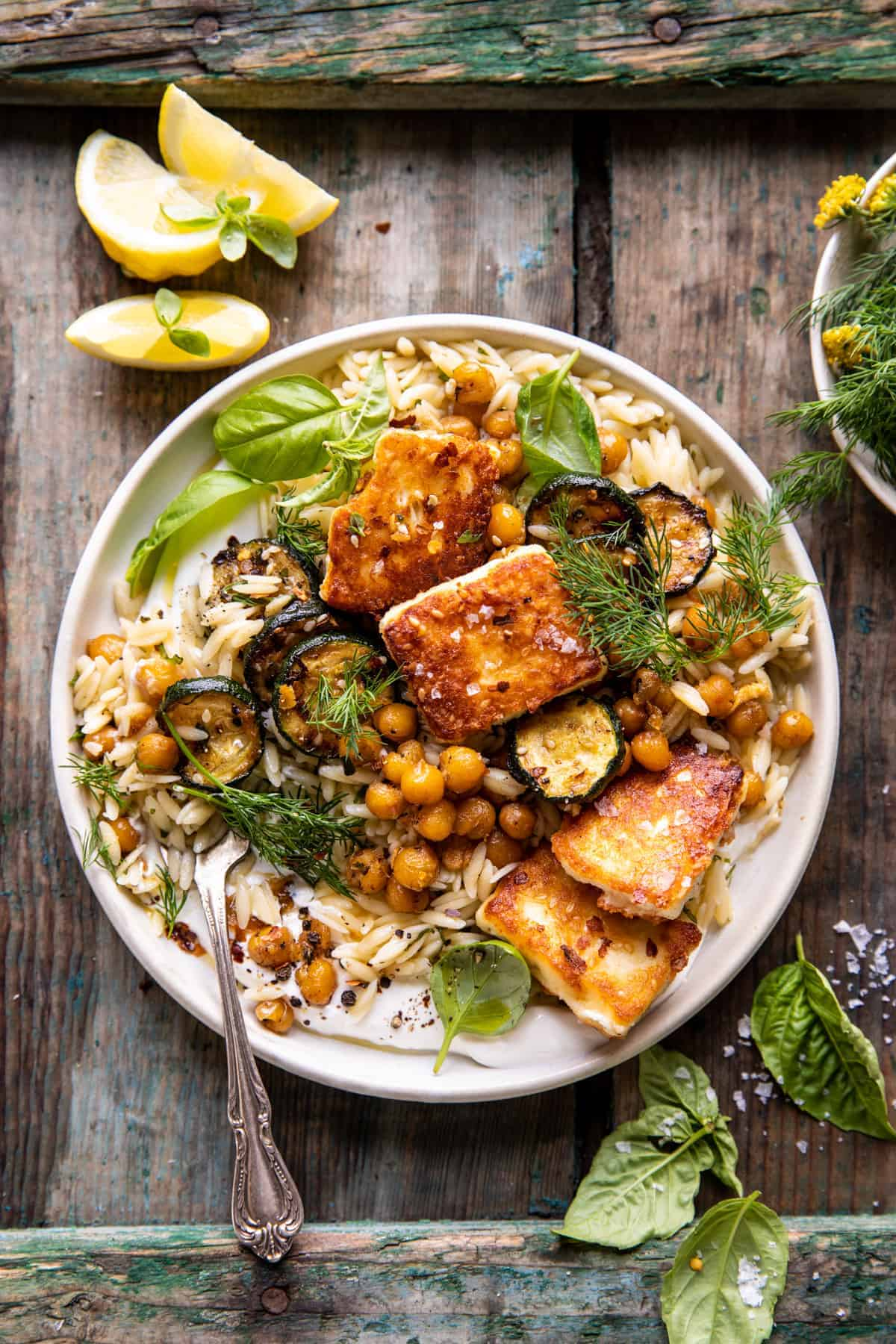 Weekly meal plan ideas: Crispy Lemon Feta with Spiced Chickpeas and Basil Orzo at Halfbaked Harvest