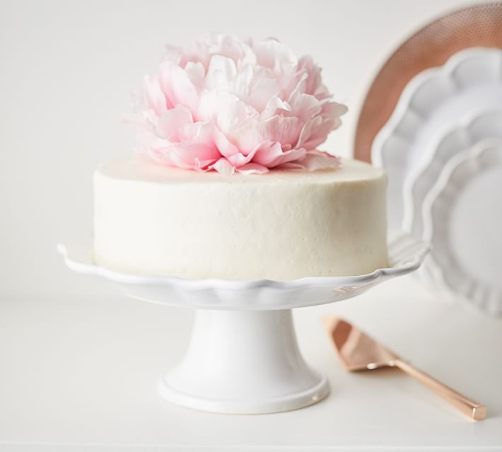 This Monique Lhuiller scalloped white cake stand at Pottery Barn shows off a birthday cake beautifully