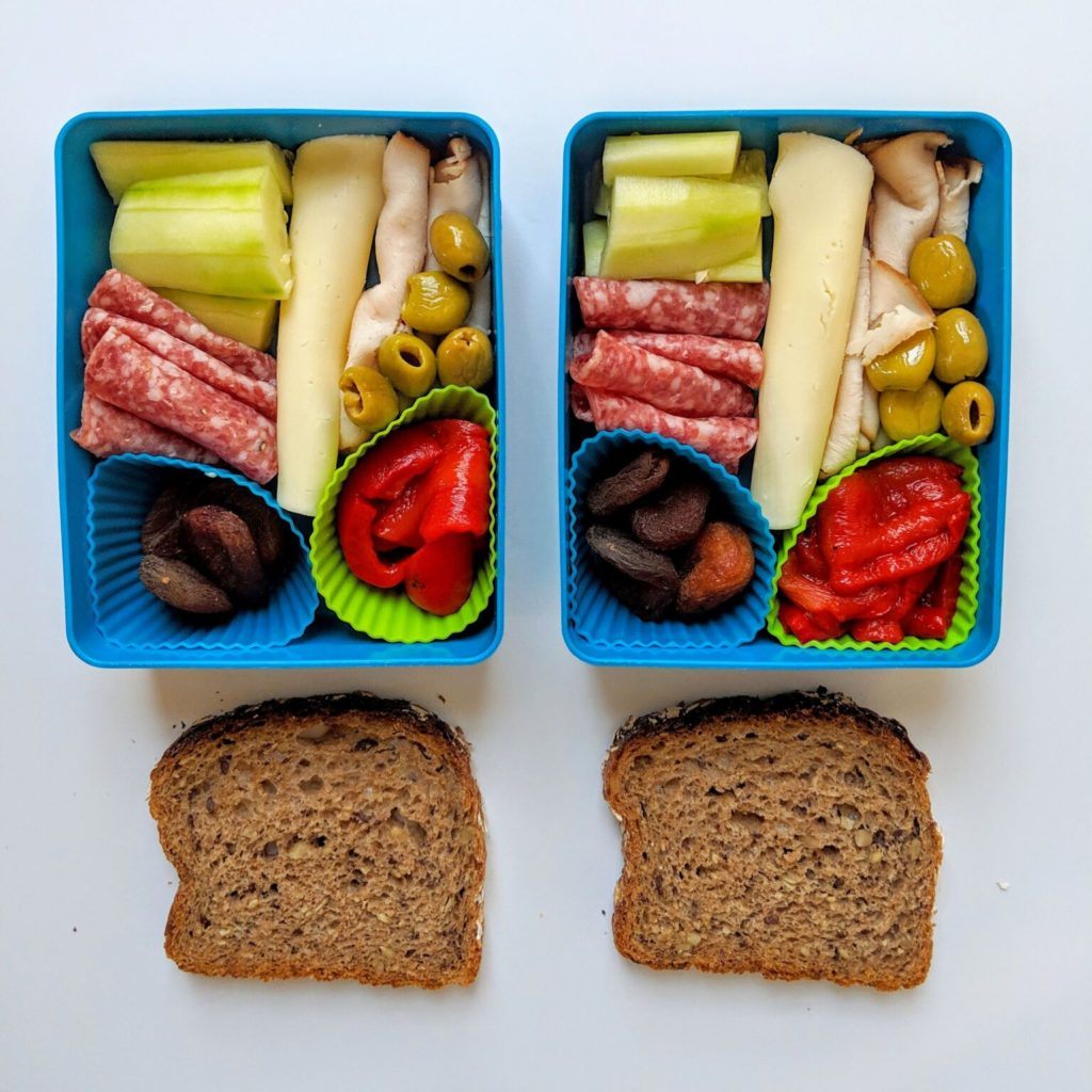 Nourished Not Famished uses cupcake liners to keep foods separated in this charcuterie style school lunch idea