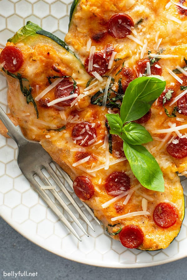 Meal Plan Ideas featuring zucchini! Pizza-Stuffed-Zucchini-Boats-from-BellyFull