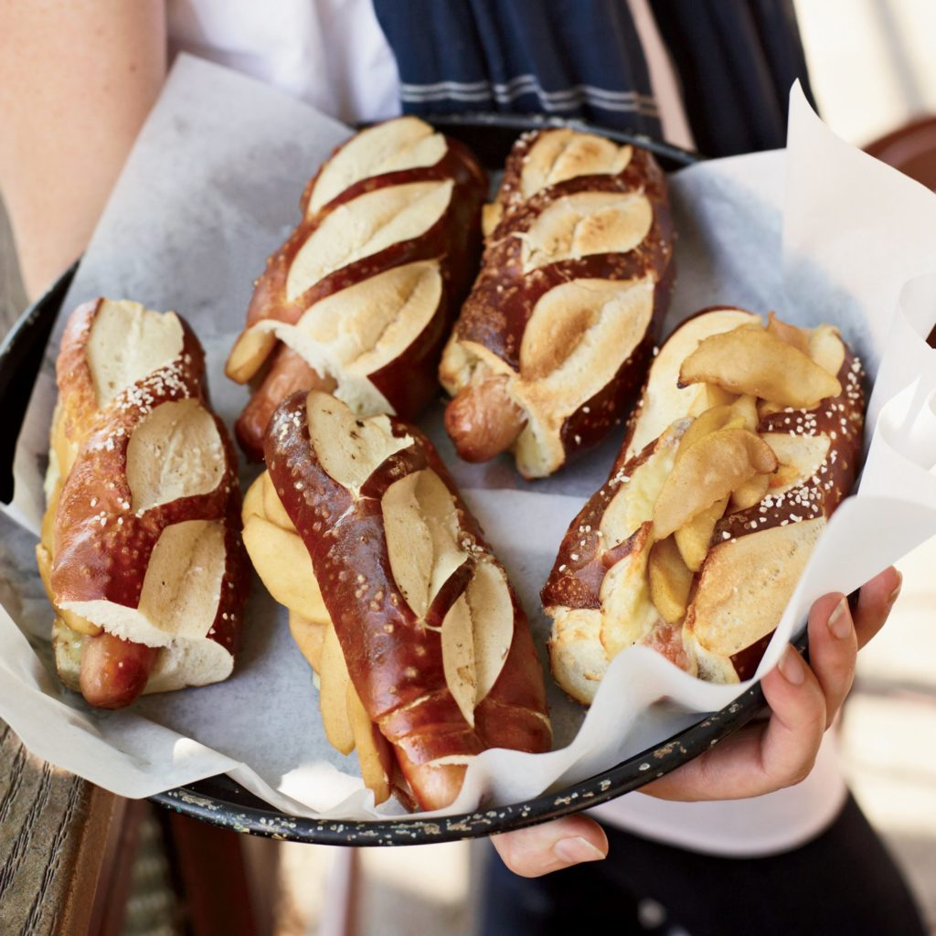 Make hot dogs and cheddar with sauteed apples for dinner with this recipe from Food and Wine